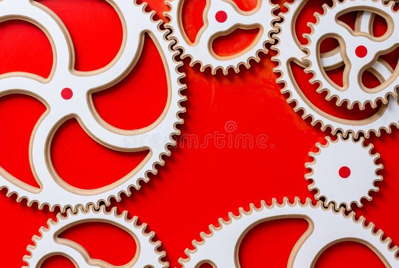 μηχανισμός άσπρο εργαλείο σε ένα κόκκινο υπόβαθρο ένας ελεύθερου χώρου στο γ απεικόνιση αποθεμάτων