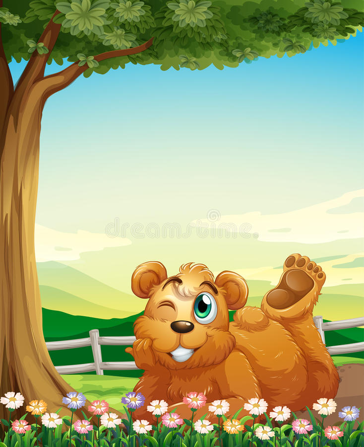 Μια αρκούδα κάτω από το δέντρο κοντά στα λουλούδια ελεύθερη απεικόνιση δικαιώματος