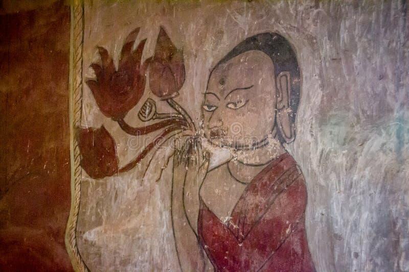Μια βουδιστική εικόνα θρησκείας (νωπογραφία) στοκ εικόνες