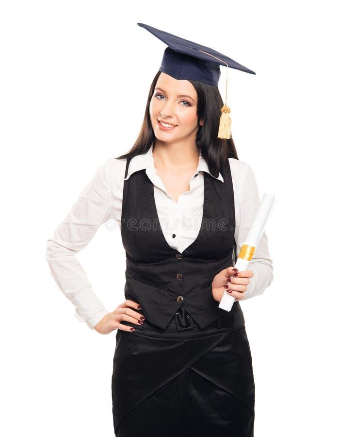 Μια γυναίκα νέων πτυχιούχων με έναν βαθμό διπλωμάτων στοκ εικόνες