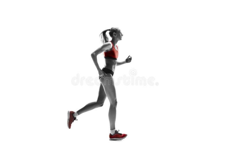 Μια καυκάσια γυναίκα που τρέχει στο άσπρο υπόβαθρο στοκ φωτογραφία