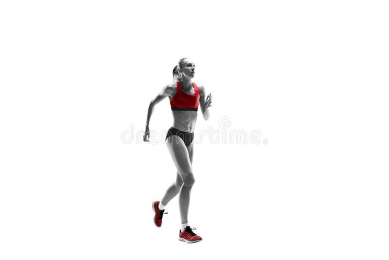 Μια καυκάσια γυναίκα που τρέχει στο άσπρο υπόβαθρο στοκ φωτογραφίες
