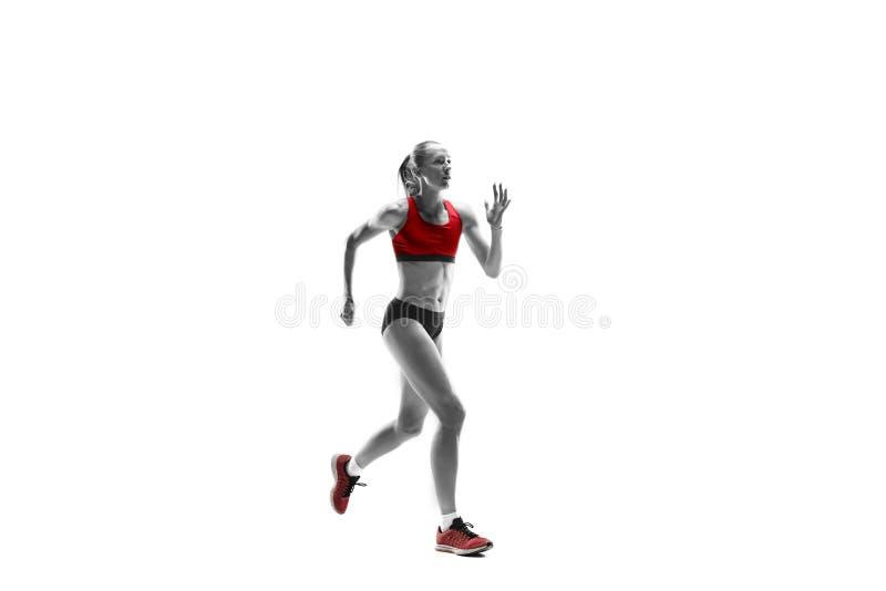 Μια καυκάσια γυναίκα που τρέχει στο άσπρο υπόβαθρο στοκ εικόνες με δικαίωμα ελεύθερης χρήσης