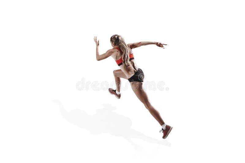 Μια καυκάσια γυναίκα που τρέχει στο άσπρο υπόβαθρο στοκ εικόνα