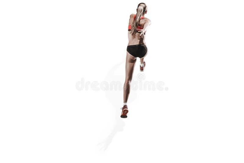 Μια καυκάσια γυναίκα που τρέχει στο άσπρο υπόβαθρο στοκ εικόνες