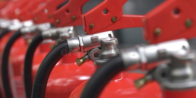 μια κινηματογράφηση σε πρώτο πλάνο έναν τρισδιάστατο σειρών πυροσβεστήρων που διευκρινίζεται από απεικόνιση αποθεμάτων