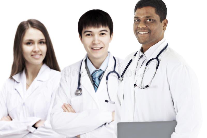 Μια ομάδα καλών γιατρών Απομονωμένη άσπρη ανασκόπηση στοκ εικόνες με δικαίωμα ελεύθερης χρήσης