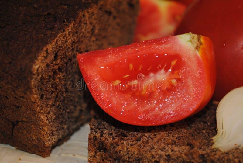 Μια φέτα της ντομάτας στοκ φωτογραφία με δικαίωμα ελεύθερης χρήσης