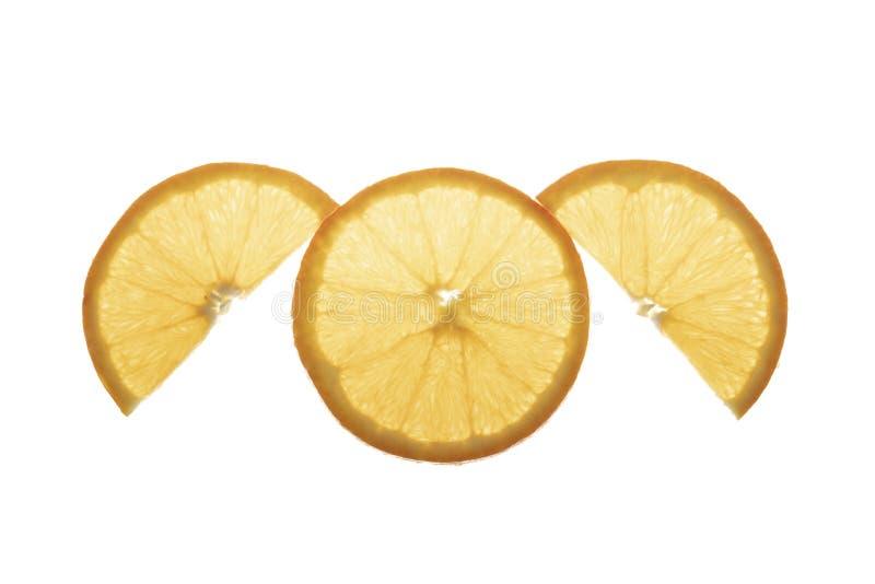 Μια φέτα του πορτοκαλιού και μισή φέτα δύο στοκ εικόνες