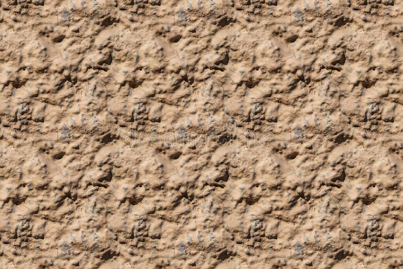 Μια όμορφη οριζόντια σύσταση μέρους ενός παλαιού τοίχου με το κίτρινο και πορτοκαλί ασβεστοκονίαμα στη φωτογραφία r στοκ φωτογραφία με δικαίωμα ελεύθερης χρήσης