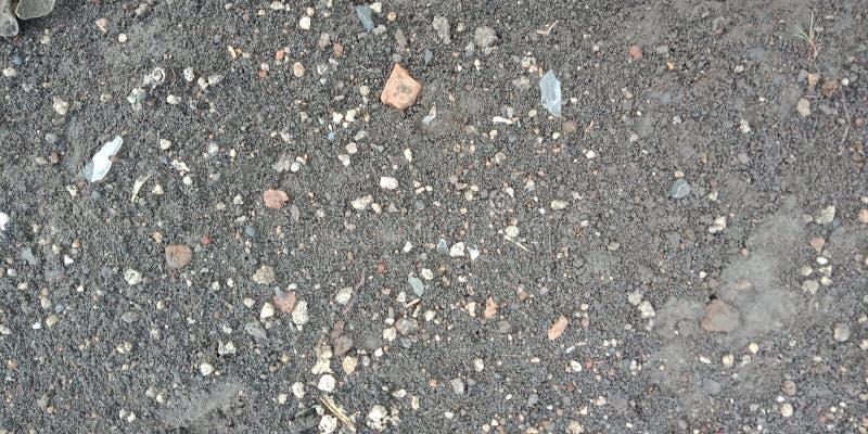 Μικρή άσπρη πέτρα στην ταπετσαρία υποβάθρου φύσης οδικού κατασκευασμένη υποβάθρου, στοκ φωτογραφία με δικαίωμα ελεύθερης χρήσης