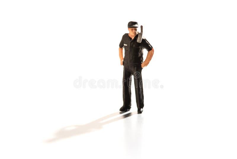 Μικροσκοπική φρουρά ασφάλειας με το ραδιόφωνο στο καθήκον στοκ εικόνες