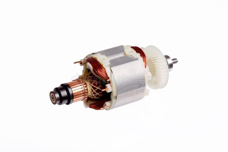 Μικρός ηλεκτρικός κινητήρας στο άσπρο υπόβαθρο στοκ εικόνα
