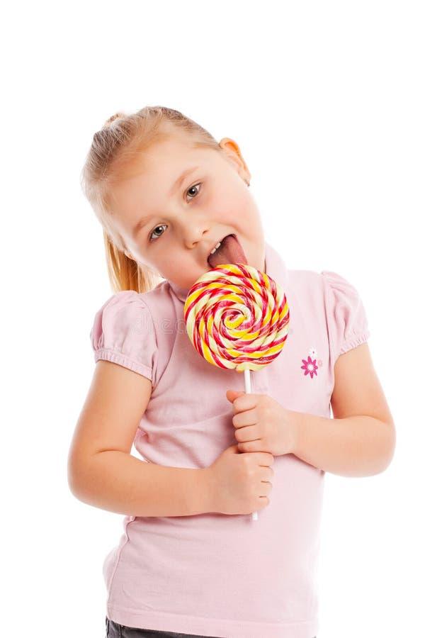 Μικρό κορίτσι με ένα μεγάλο lollipop. στοκ φωτογραφία