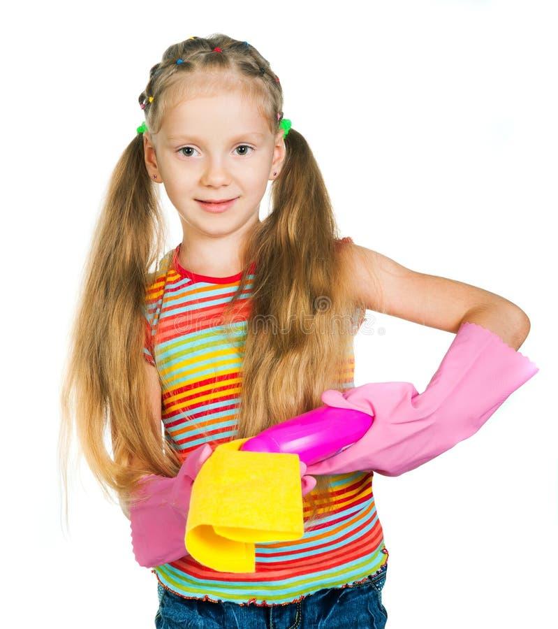 Μικρό κορίτσι με τα απορρυπαντικά στοκ φωτογραφία