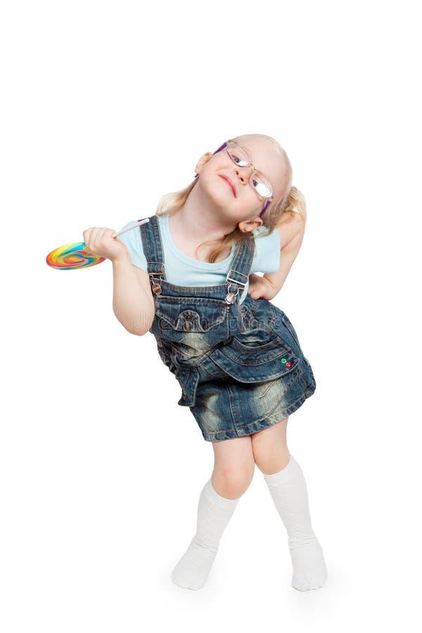 Μικρό κορίτσι με το μεγάλο lollipop στοκ εικόνα