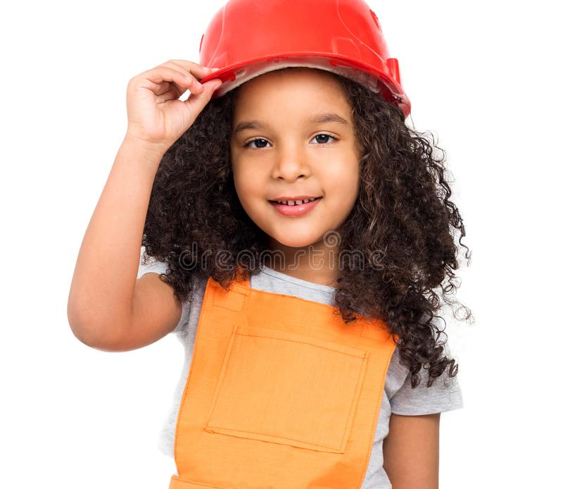 Μικρό κορίτσι σε ομοιόμορφο επισκευαστών που απομονώνεται πορτοκαλή στοκ φωτογραφία με δικαίωμα ελεύθερης χρήσης