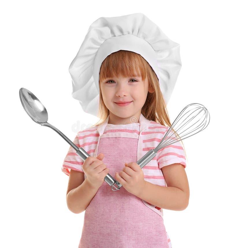 Μικρό κορίτσι στο καπέλο αρχιμαγείρων στο άσπρο υπόβαθρο στοκ εικόνες