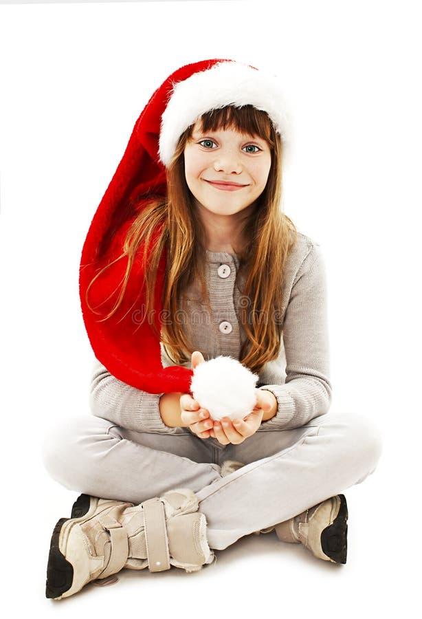 Μικρό κορίτσι στο κόκκινο καπέλο Santa στοκ εικόνες με δικαίωμα ελεύθερης χρήσης