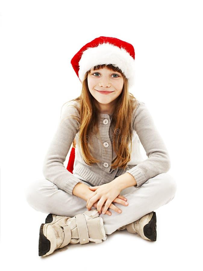 Μικρό κορίτσι στο κόκκινο καπέλο Santa στοκ εικόνες