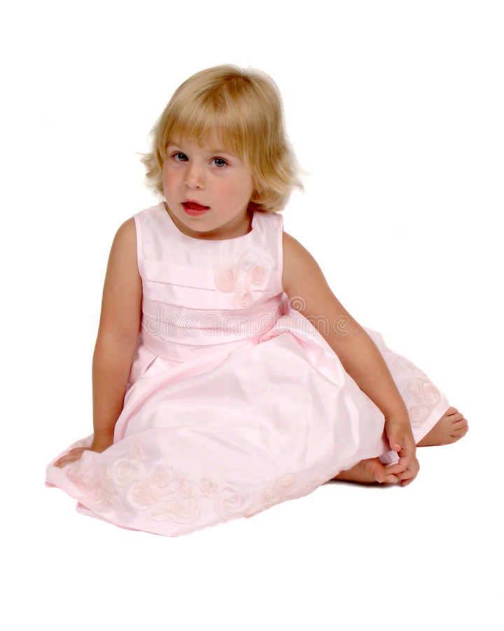 Μικρό κορίτσι στο ρόδινο φόρεμα στοκ εικόνες
