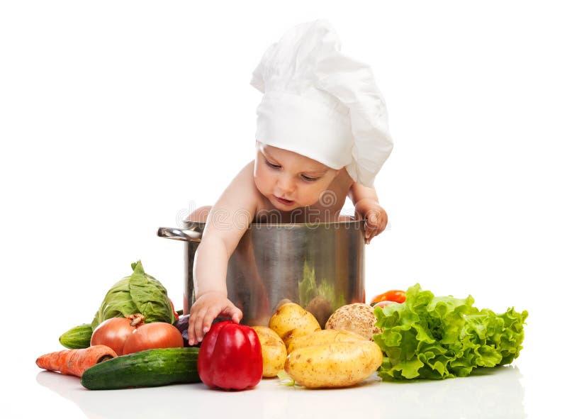 Μικρό παιδί στο καπέλο του αρχιμάγειρα στοκ εικόνες