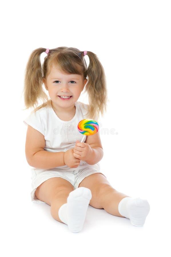 Download μικρό χαμόγελο κοριτσιών Loll Στοκ Εικόνα - εικόνα από κατανάλωση, εκμετάλλευση: 17051183