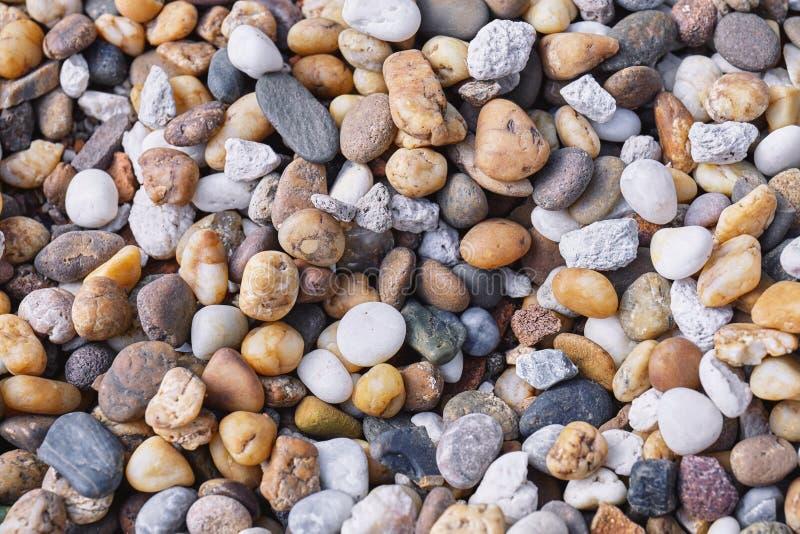 Μικτός πολύχρωμου του υποβάθρου πετρών χαλικιών στοκ εικόνες