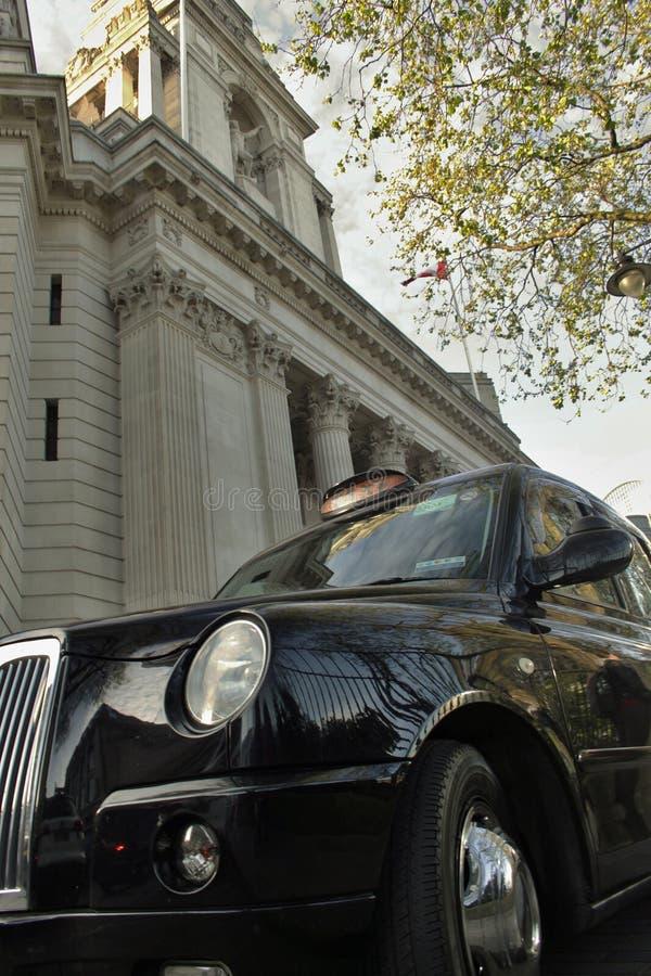 μισθώστε το ελαφρύ ταξί του Λονδίνου του που γυρίζουν στοκ εικόνα με δικαίωμα ελεύθερης χρήσης