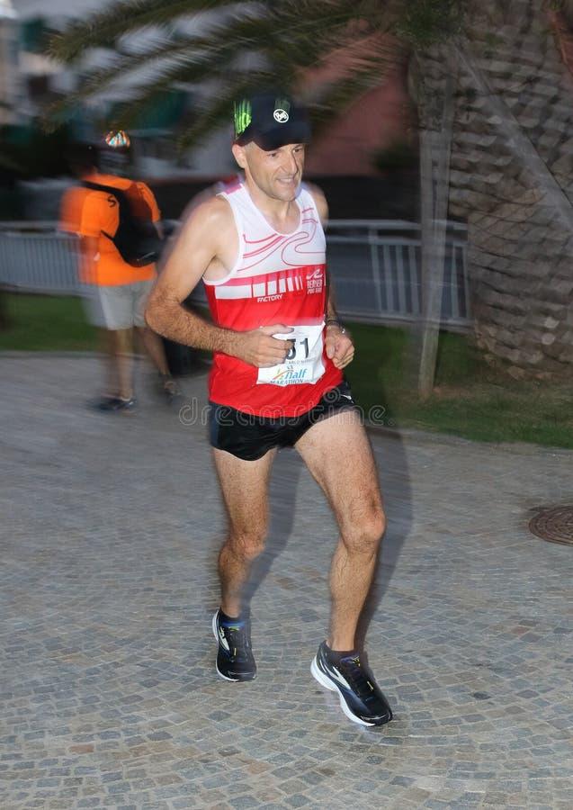Μισός μαραθώνιος Arenzano, στις 7 Σεπτεμβρίου 2018: μερικοί από τους αθλητές δέσμευσαν κατά τη διάρκεια του αγώνα στοκ φωτογραφίες