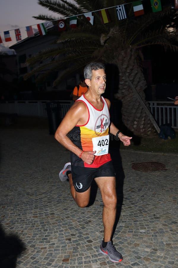 Μισός μαραθώνιος Arenzano, στις 7 Σεπτεμβρίου 2018: μερικοί από τους αθλητές δέσμευσαν κατά τη διάρκεια του αγώνα στοκ εικόνες με δικαίωμα ελεύθερης χρήσης