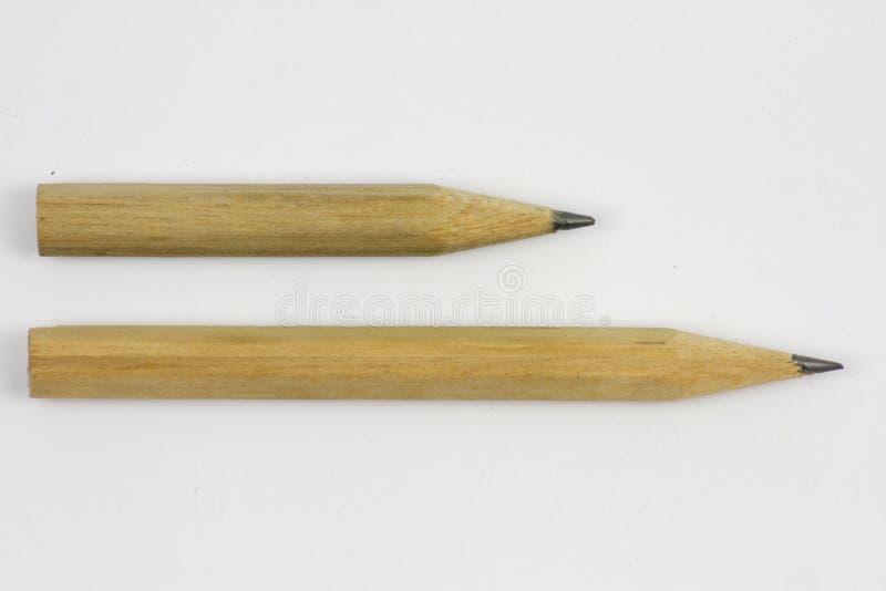 """Μολύβι με Ï""""Î¿ ακόνισμα στο υπόβαθρο της Λευκής Βίβλου στοκ εικόνα"""
