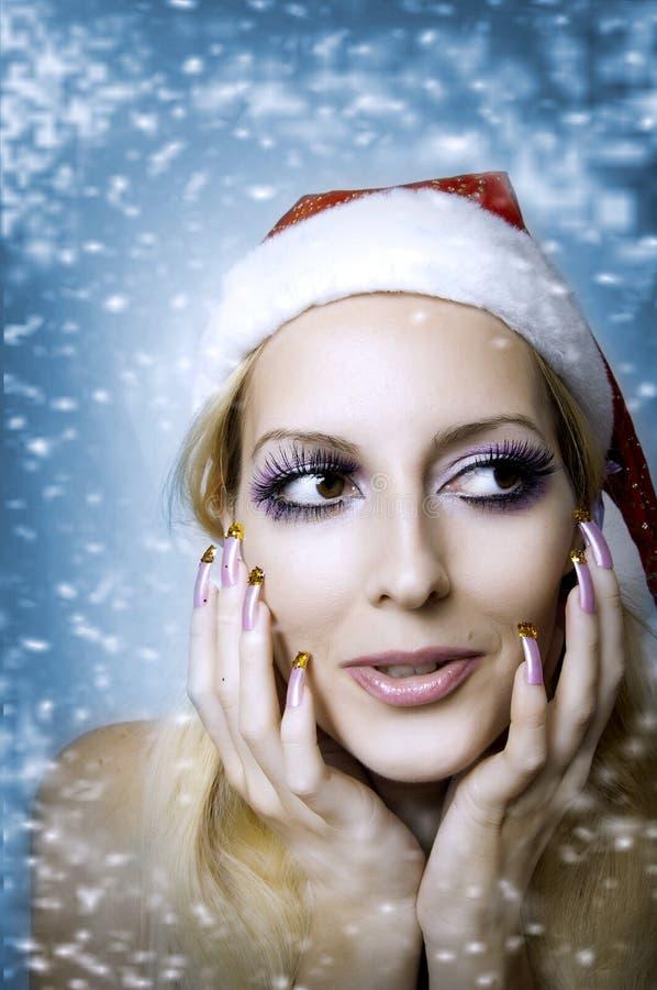 Μοντέλο γυναικών. Φωτεινή σύνθεση Χριστουγέννων στοκ φωτογραφία