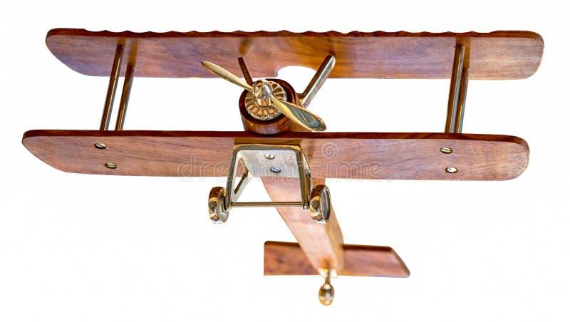 Μοντέλο ξύλινου αεροπλάνου που απογειώνει την κάτω όψη απομονωμένο σε λευκό στοκ εικόνες