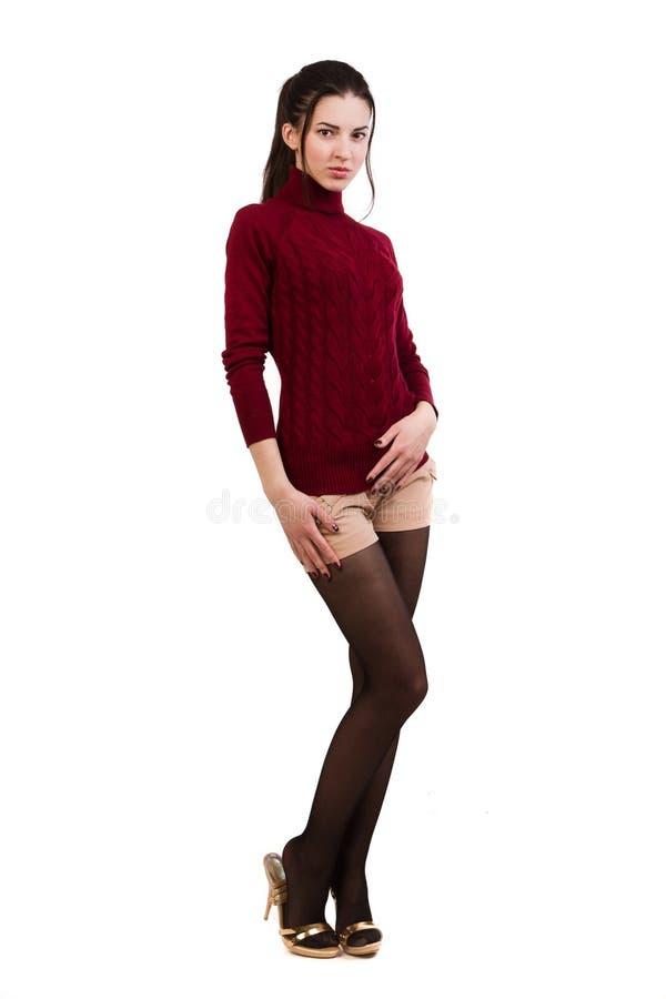 Μοντέρνο κορίτσι στο κόκκινο πέρα από το λευκό στοκ φωτογραφία με δικαίωμα ελεύθερης χρήσης