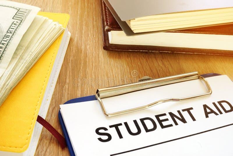 Μορφή και χρήματα ενίσχυσης σπουδαστών για την εκπαίδευση στοκ φωτογραφία με δικαίωμα ελεύθερης χρήσης