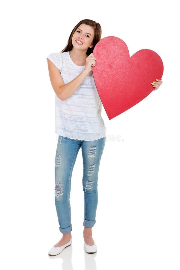 Μορφή καρδιών κοριτσιών εφήβων στοκ εικόνες