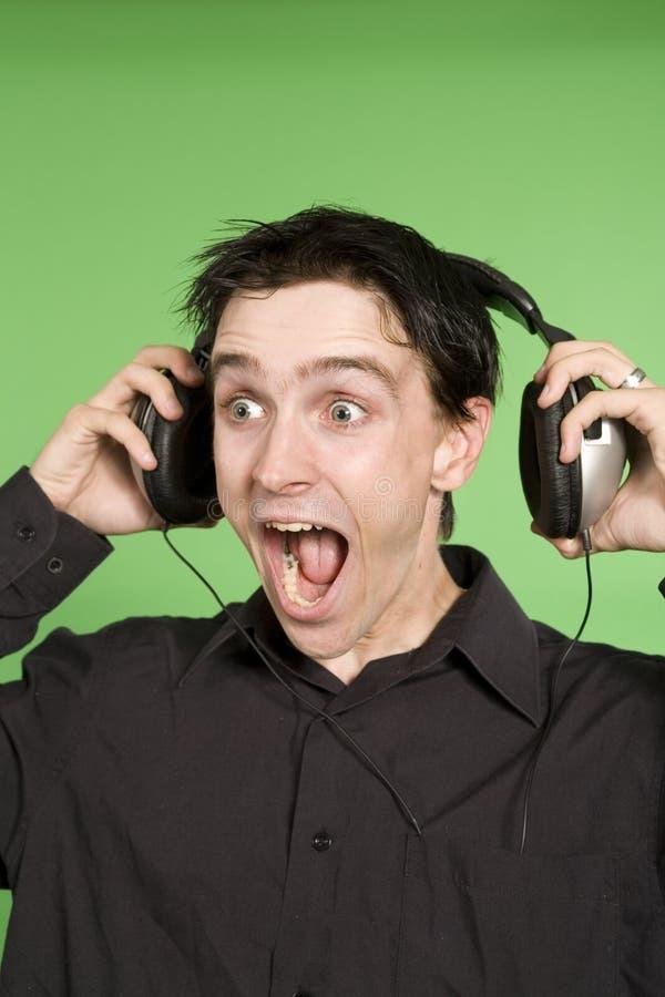 μουσική ατόμων ακούσματος σε unplaisant στοκ εικόνες με δικαίωμα ελεύθερης χρήσης