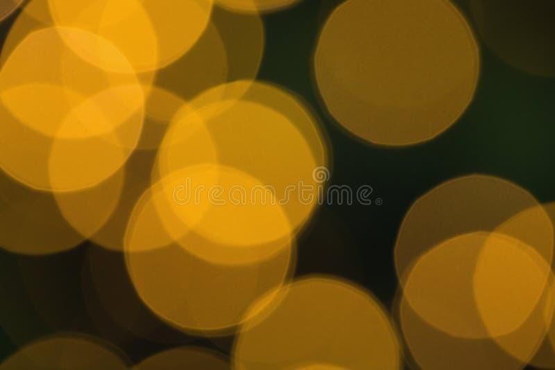 Μουτζουρωμένοι κίτρινοι ελαφριοί κύκλοι Χριστουγέννων στοκ φωτογραφίες