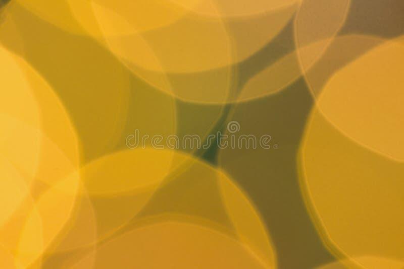 Μουτζουρωμένοι κίτρινοι ελαφριοί κύκλοι Χριστουγέννων στοκ εικόνα με δικαίωμα ελεύθερης χρήσης