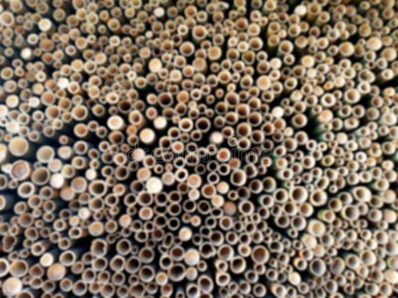 Μουτζουρωμένο Backgroud των τρυπών του τέμνοντος αφηρημένου υποβάθρου μπαμπού στοκ εικόνες