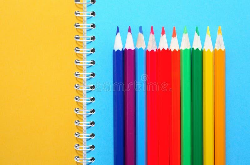 Μολύβια στο σημειωματάριο στοκ εικόνα με δικαίωμα ελεύθερης χρήσης