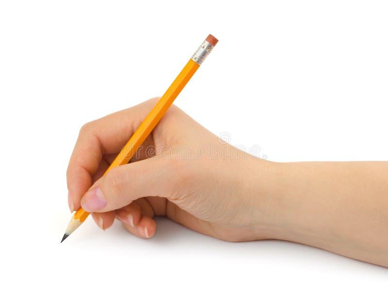 Μολύβι στο χέρι γυναικών στοκ φωτογραφία με δικαίωμα ελεύθερης χρήσης