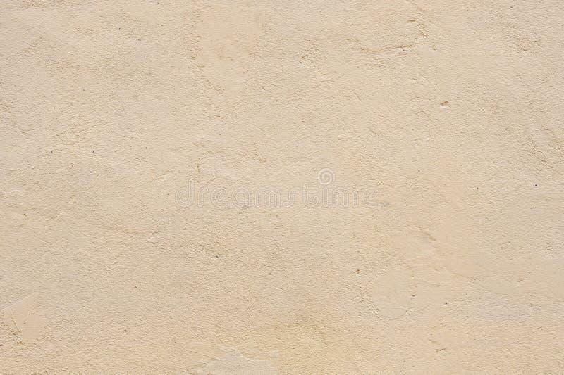 Μπεζ βαμμένος τσιμενταρισμένος τοίχος σύστασης, που ευθυγραμμίζεται μαλακά Εξωτερικός εξωτερικός τοίχος σύστασης των εξωτερικών τ στοκ εικόνες με δικαίωμα ελεύθερης χρήσης