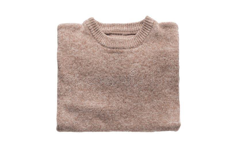Μπεζ διπλωμένο πουλόβερ στοκ φωτογραφίες
