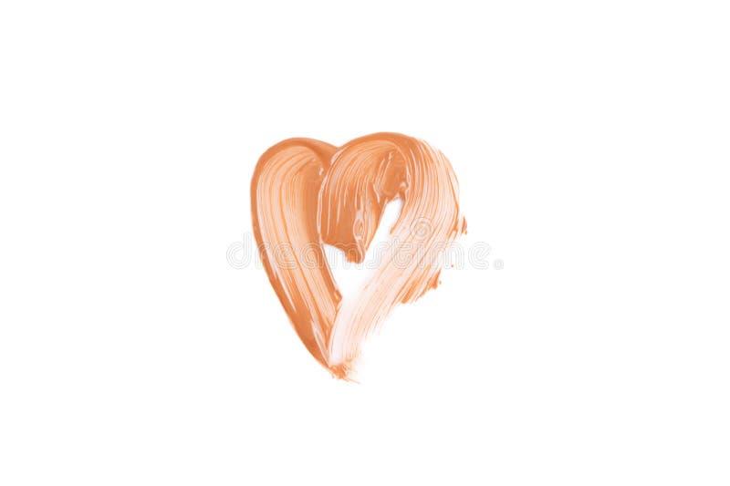 Μπεζ κηλίδα της καρδιάς ιδρύματος που διαμορφώνεται Έννοια καλλυντικών που απομονώνεται στο άσπρο υπόβαθρο στοκ εικόνες