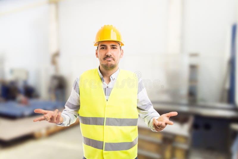Μπερδεμένος εργάτης που ρωτά τη χειρονομία στοκ φωτογραφίες με δικαίωμα ελεύθερης χρήσης