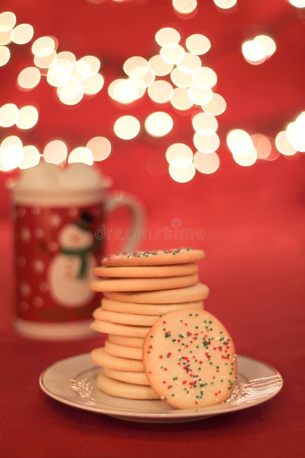 Μπισκότα Χριστουγέννων με τα φω'τα στοκ εικόνα