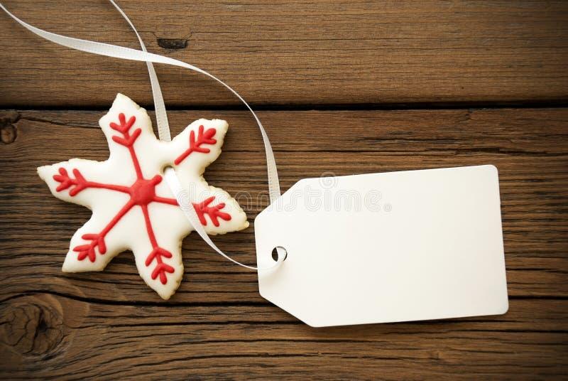Μπισκότο αστεριών Χριστουγέννων με την κενή ετικέτα στοκ εικόνες