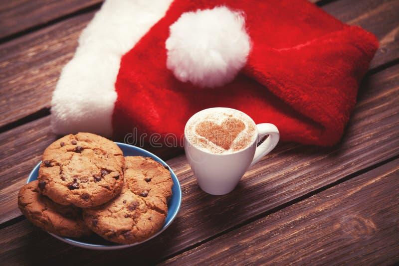Μπισκότο και φλιτζάνι του καφέ στοκ εικόνες